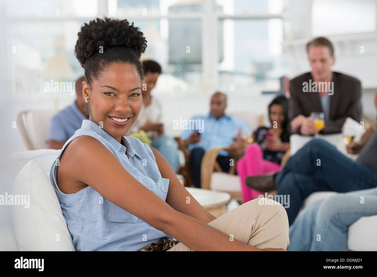 Office. A young woman smiling broadly. - Stock Image