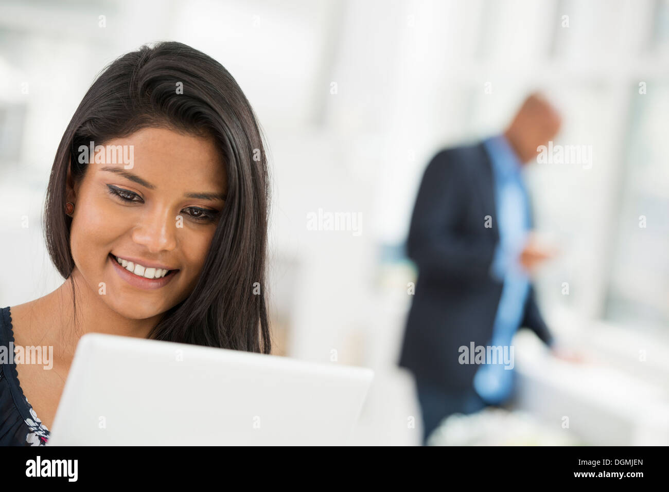 Business people. A woman using a digital tablet. - Stock Image
