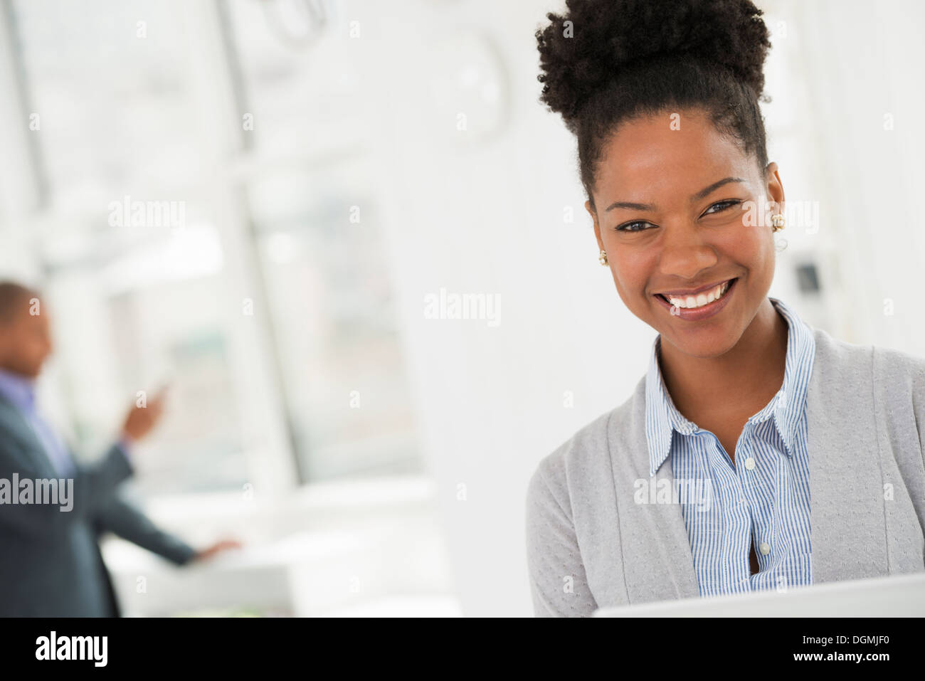 Business people. A young woman smiling. - Stock Image
