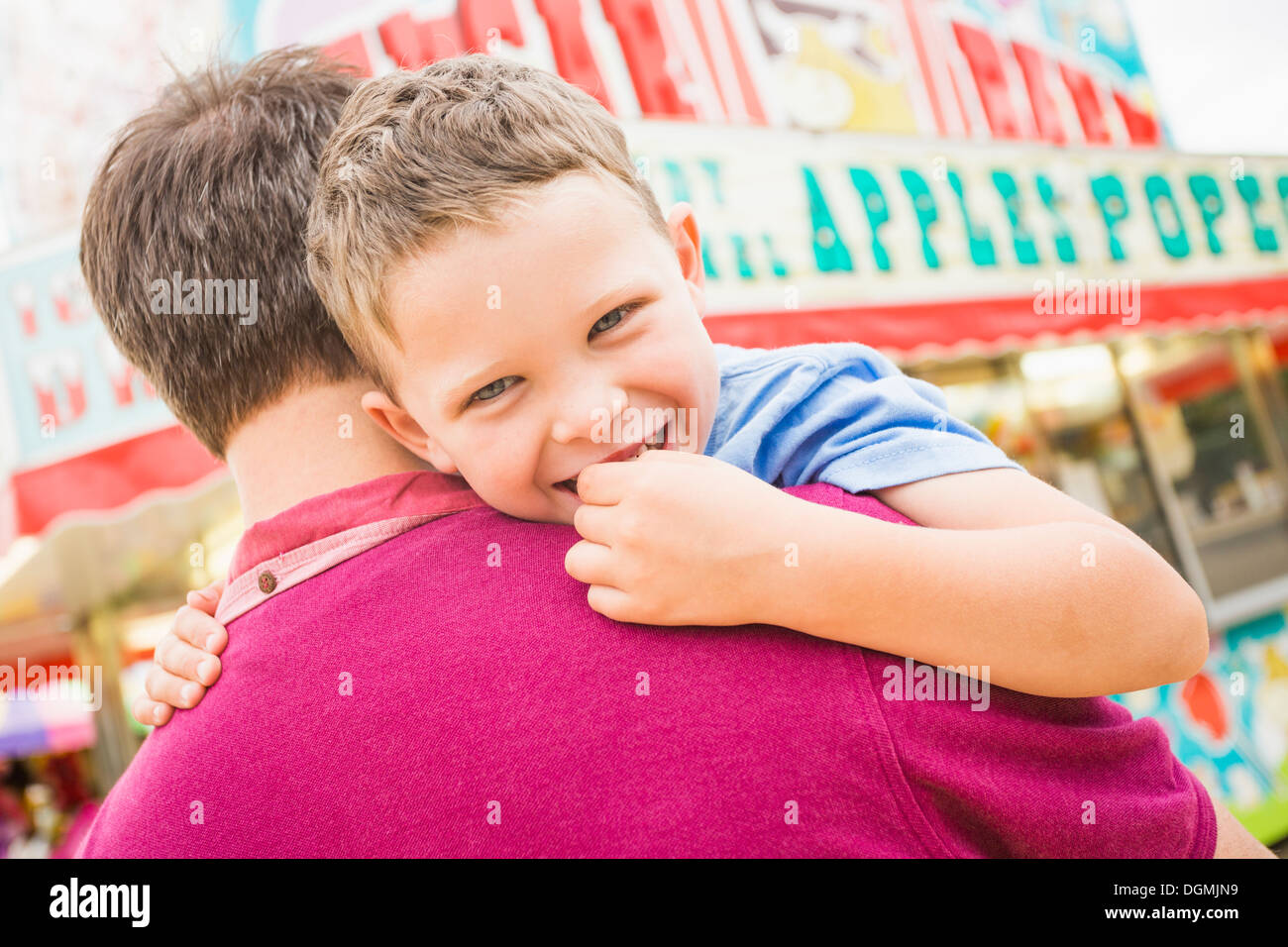 USA, Utah, Salt Lake City, Father and son (4-5) in amusement park - Stock Image