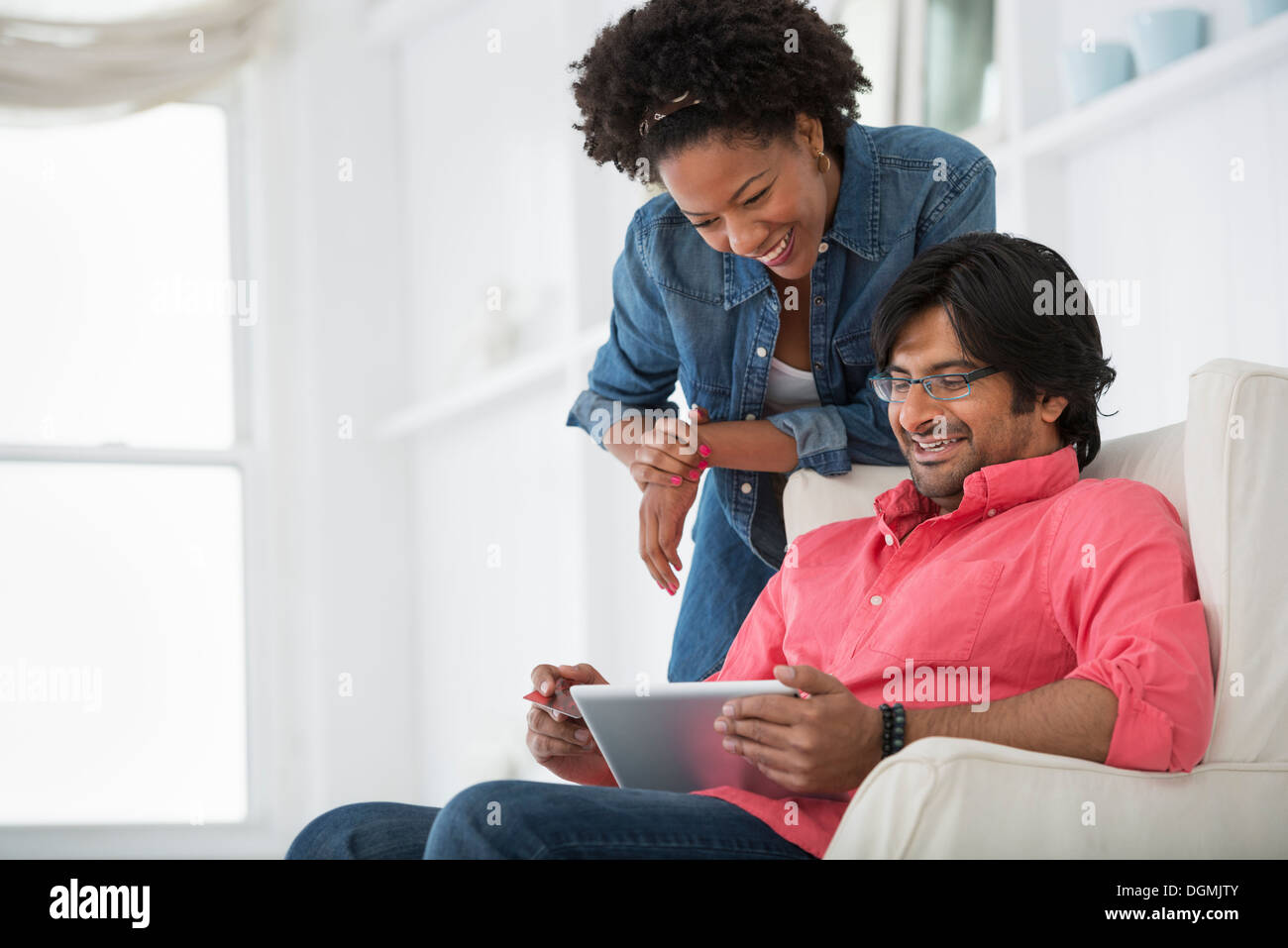 Office life. A man and woman looking at a digital tablet. Stock Photo