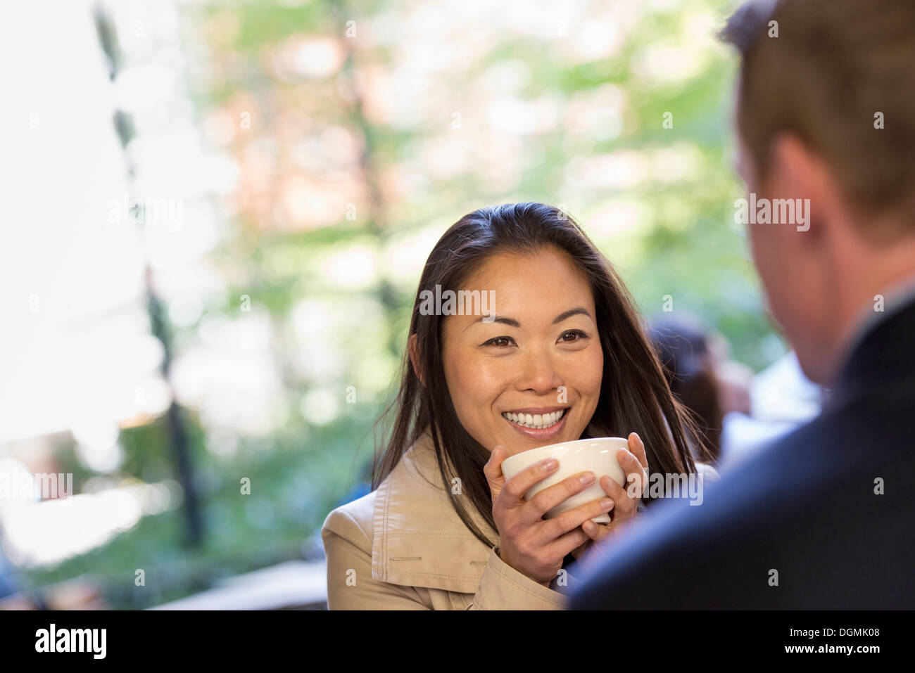 A man and woman sitting in a coffee shop. - Stock Image