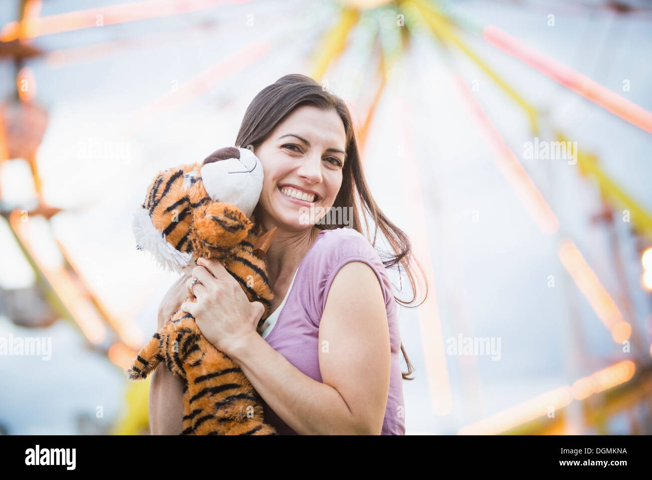 USA, Utah, Salt Lake City, Portrait of woman with toy tiger - Stock Image