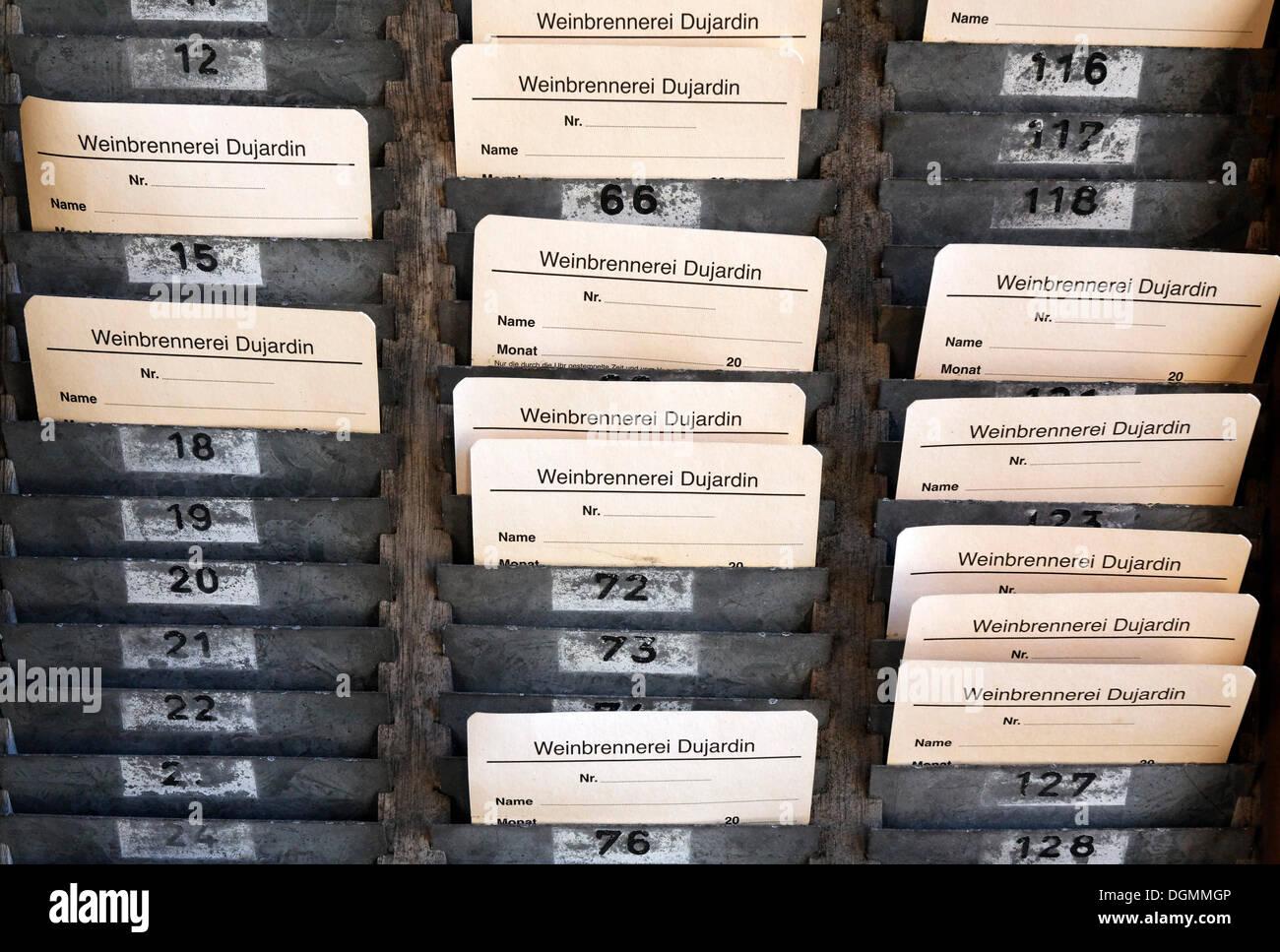 Board with time-stamped cards, time-punch machine, former Dujardin distillery, Krefeld-Uerdingen, North Rhine-Westphalia - Stock Image