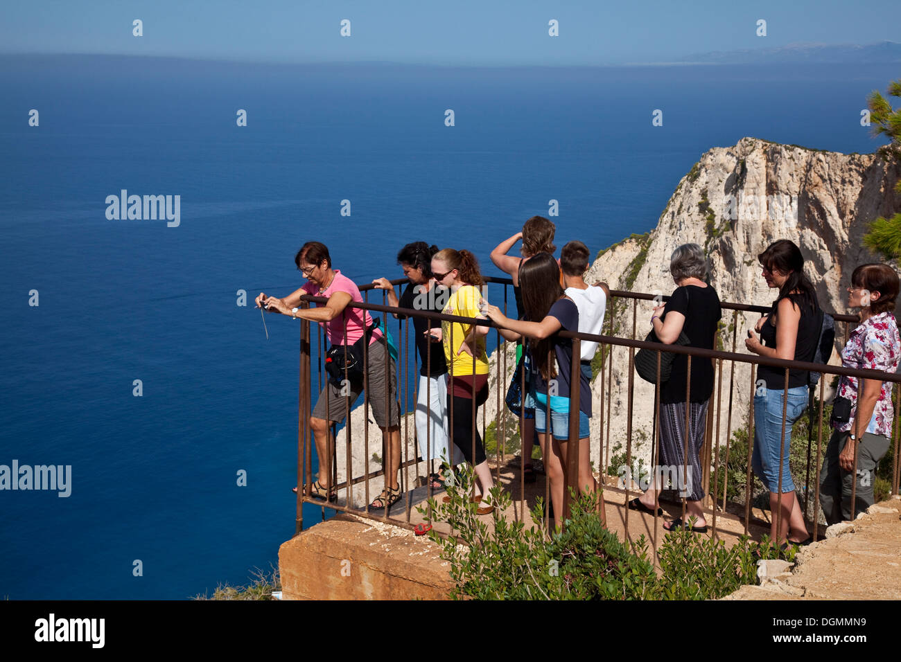 Tourists Taking Photos of Shipwreck Beach From The Viewpoint, Zakynthos (Zante) Greece - Stock Image