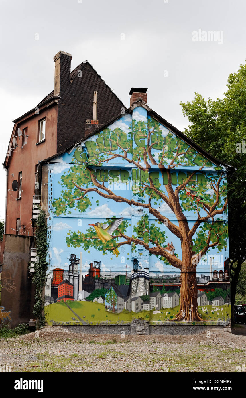 Old house about to be demolished, wall painted with a tree in an industrial landscape, Bruckhausen district, Duisburg - Stock Image