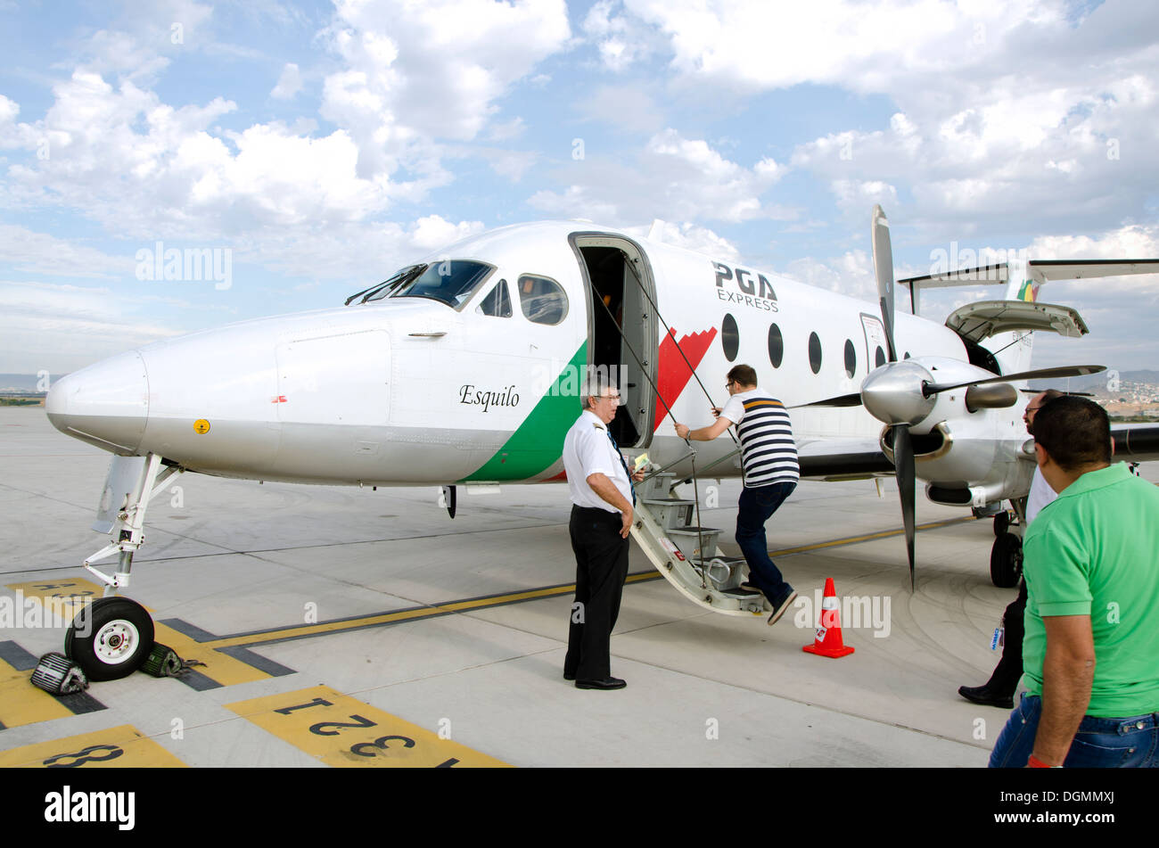 Passengers boarding a Beechcraft 1900D airplane from Tap portugal in parking position next to runway. Malaga, Spain. - Stock Image