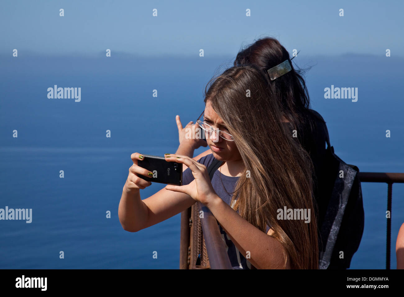 A Tourist Taking A Photograph of Shipwreck Beach From The Viewpoint, Zakynthos (Zante) Island Greece - Stock Image