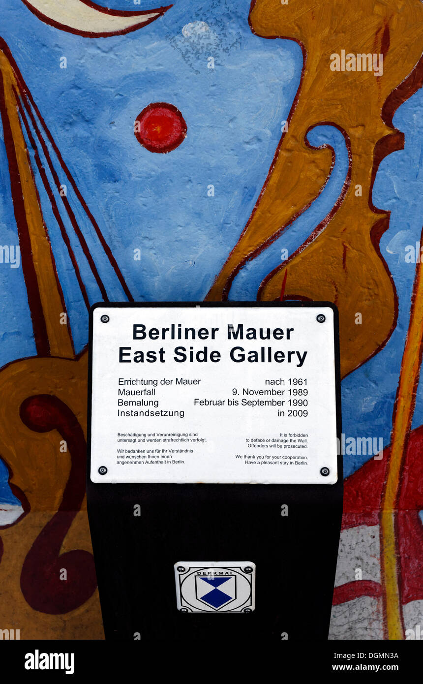 Listed building sign in front of the East Side Gallery, remants of the Berlin Wall, Friedrichshain district, Berlin - Stock Image