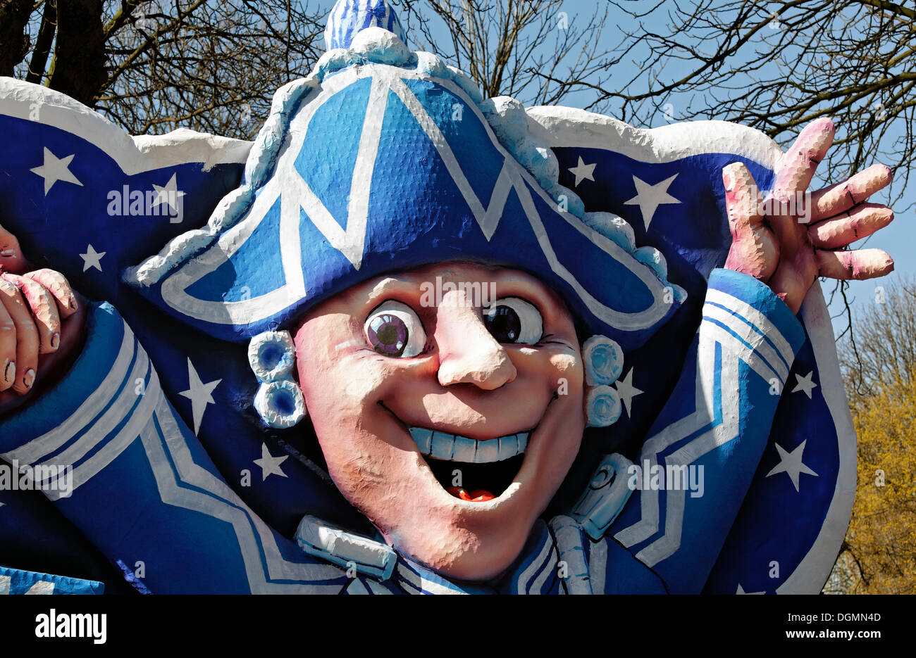 Cheerfully waving Gardist, guard wearing the blue and white Prinzengarde uniform, paper-mache figure, parade float at the - Stock Image