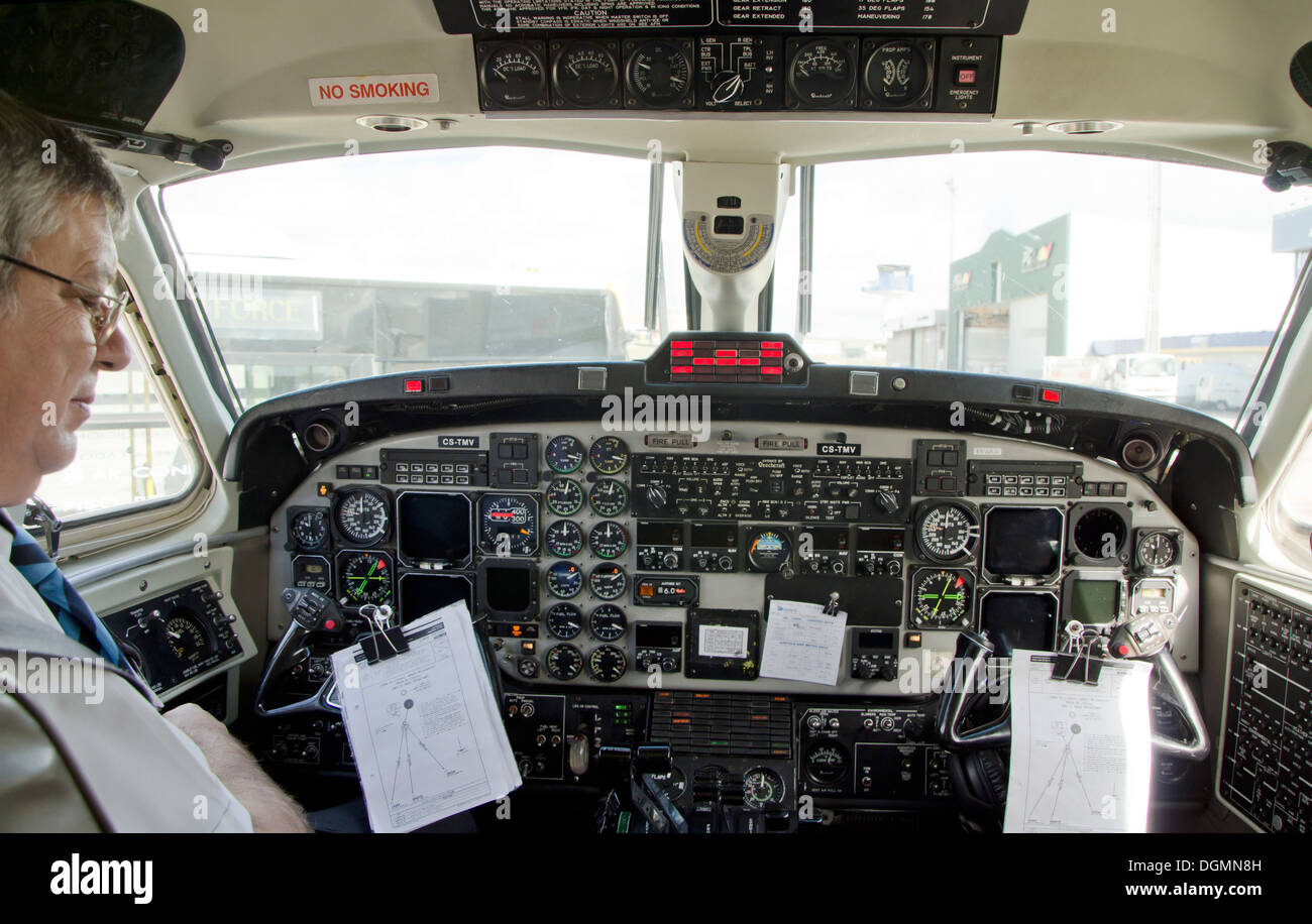 Cockpit of a Beechcraft 1900D airplane from Tap portugal in parking position next to runway. Malaga, Spain. - Stock Image