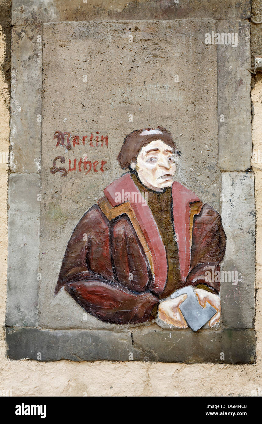 Graffito of Martin Luther holding a Bible, Weimar, Thuringia - Stock Image