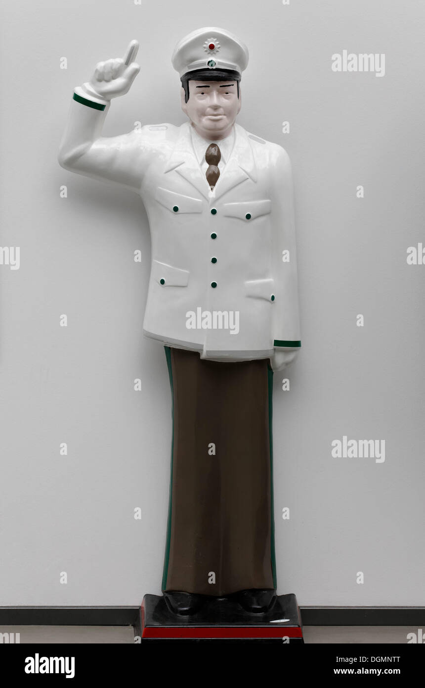 Traffic cop with a wagging finger, figure made of plastic - Stock Image