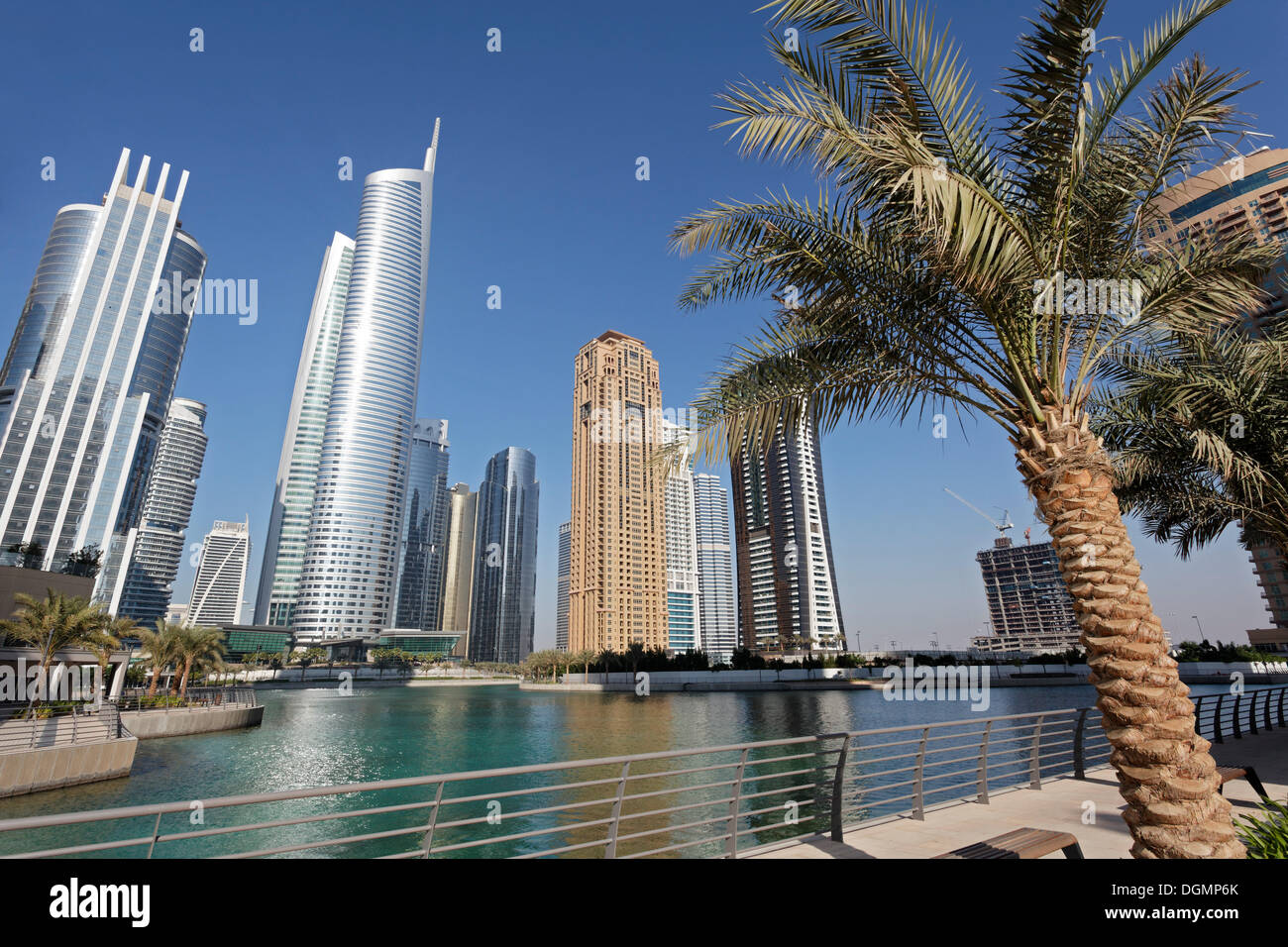 Skyscrapers on an artificial lake, large scale construction project, Jumeirah Lake Towers, Dubai, United Arab Emirates - Stock Image