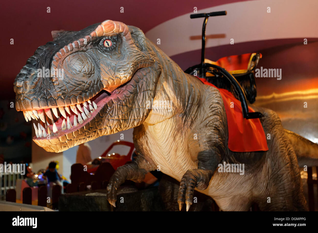 Ride a Dino for teenagers, moving dinosaurs, Mall of the Emirates, shopping centre, Dubai, United Arab Emirates, Middle East - Stock Image