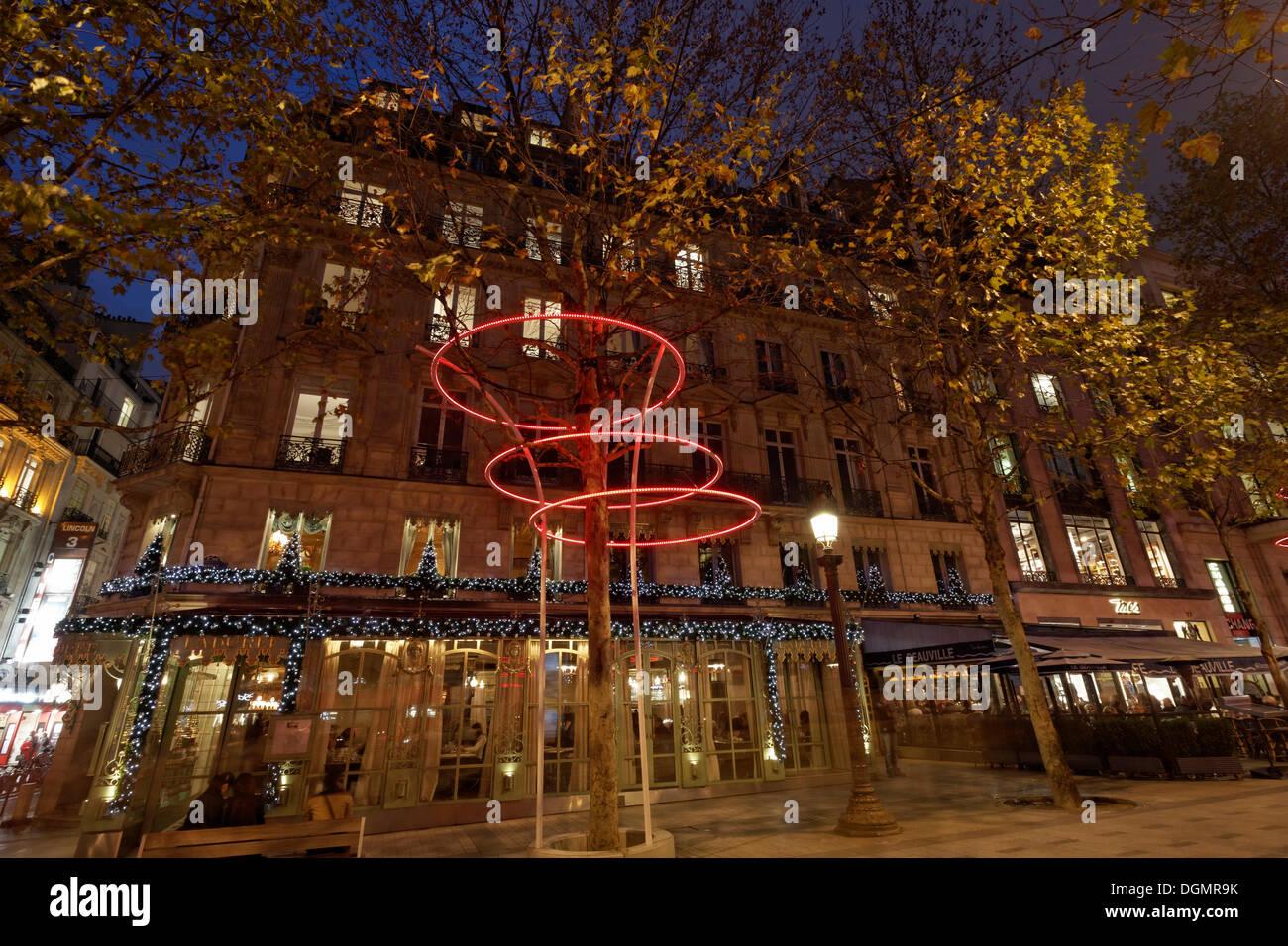 Christmas lighting in front of the Ladurée luxury patisserie, Avenue des Champs Elysées street, 8th Arrondissement, Paris - Stock Image