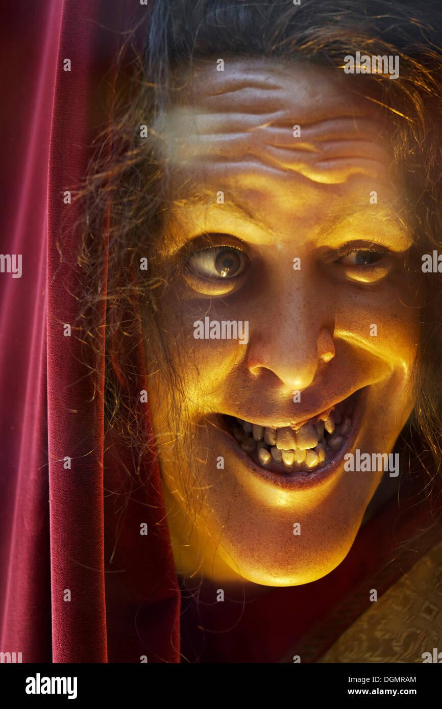 Face of a grinning wax figure with broken teeth, Musée Grevin waxwork museum, 9th Arrondissement, Paris, Ile-de-France, France - Stock Image