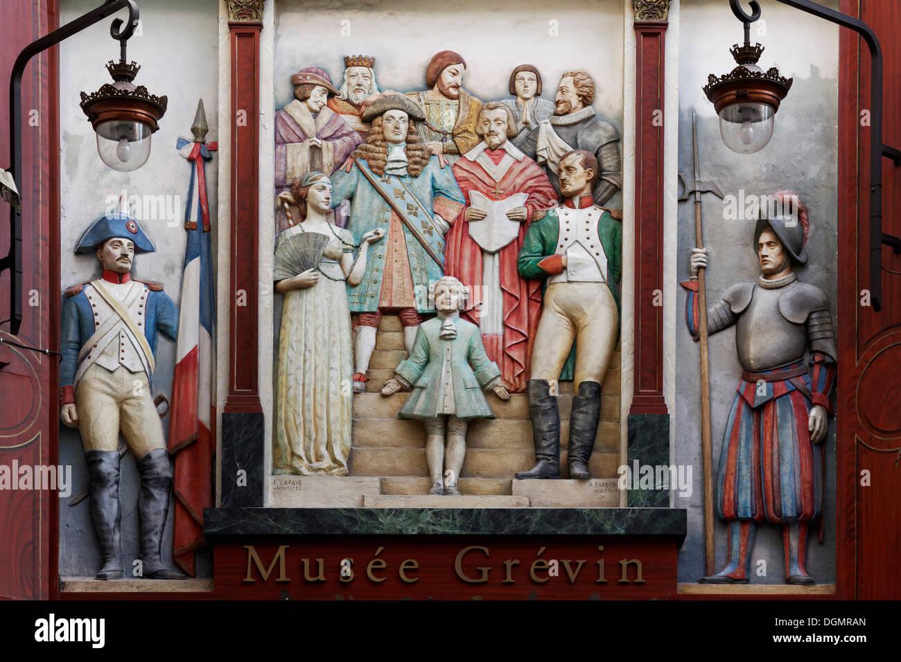 Relief with historical figures, entrance to Musée Grevin waxwork museum, Passage Jouffroy, 9th Arrondissement, Paris - Stock Image