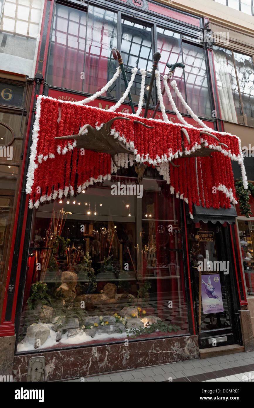 Quirky shop selling historic walking sticks, with Christmas decoration, Passage Jouffroy, Grands Boulevards, 2nd Arrondissement - Stock Image