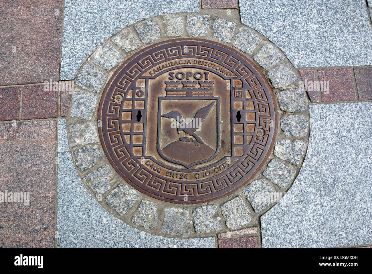 Manhole cover on the promenade of Sopot. - Stock Image