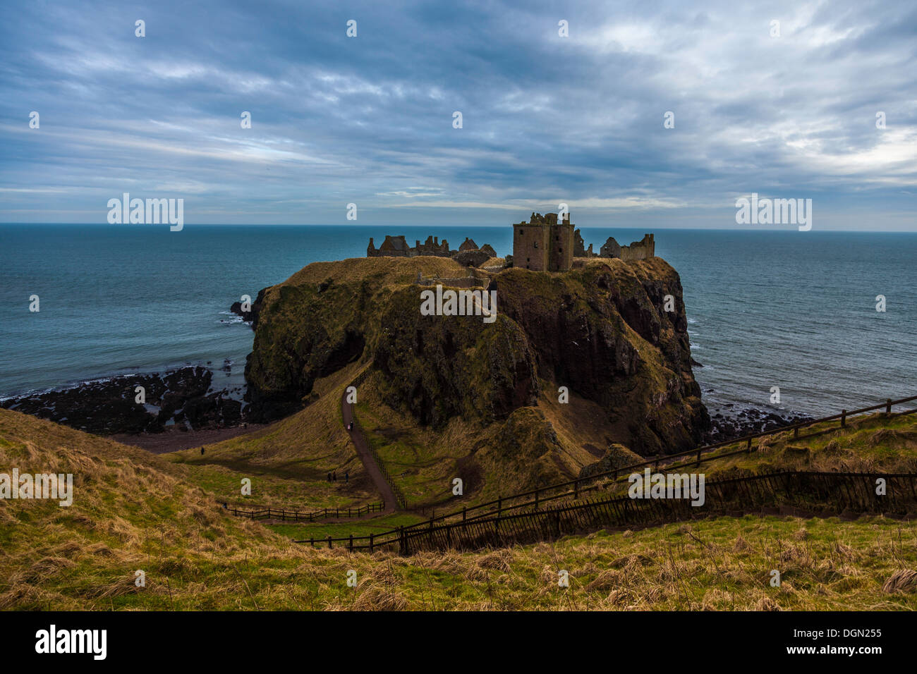 View of Dunnottar Castle with blue sea and sky in the background. - Stock Image