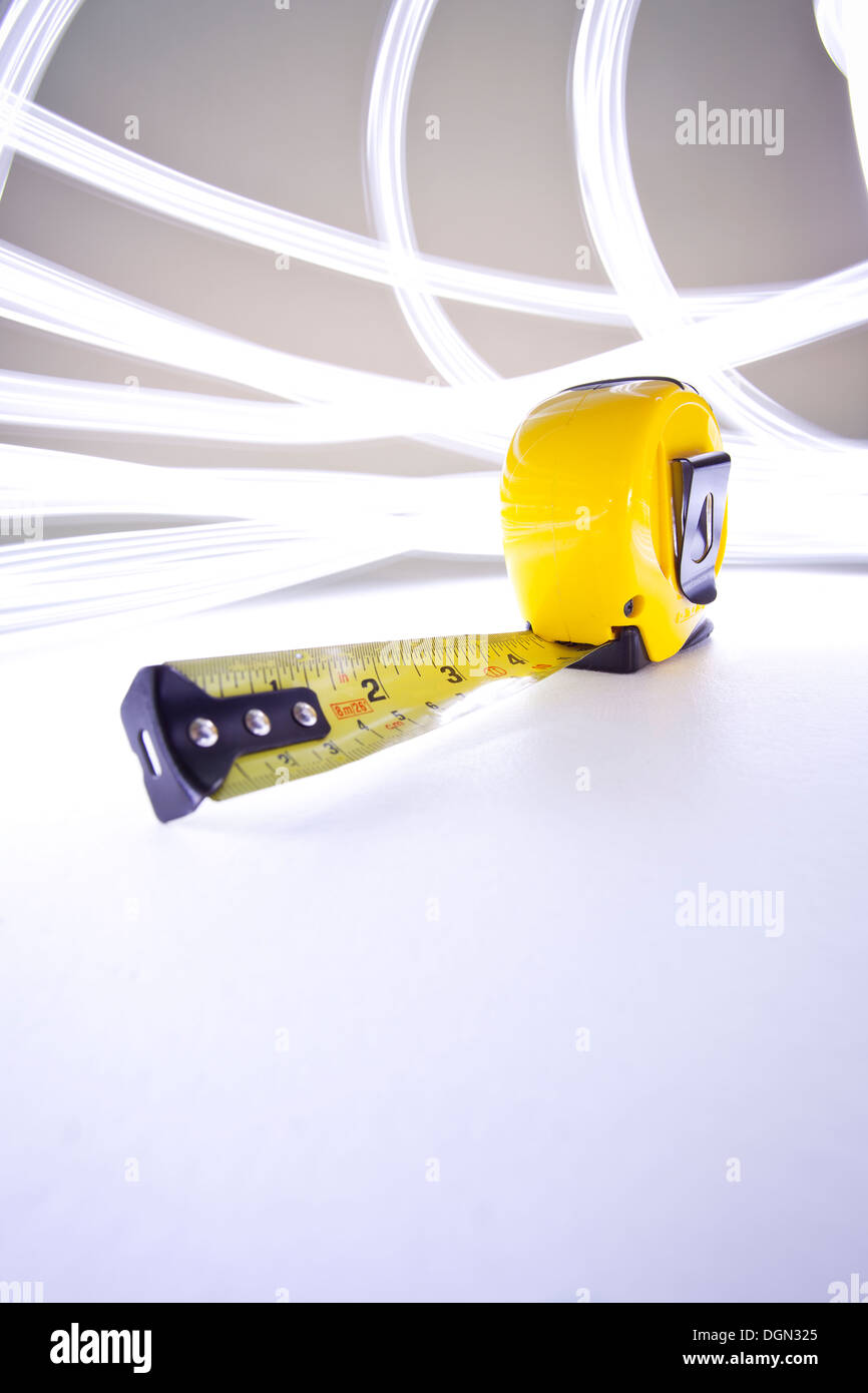 Tape measure in inches stock photos tape measure in inches stock bright yellow tape measure with light streaks stock image aloadofball Images