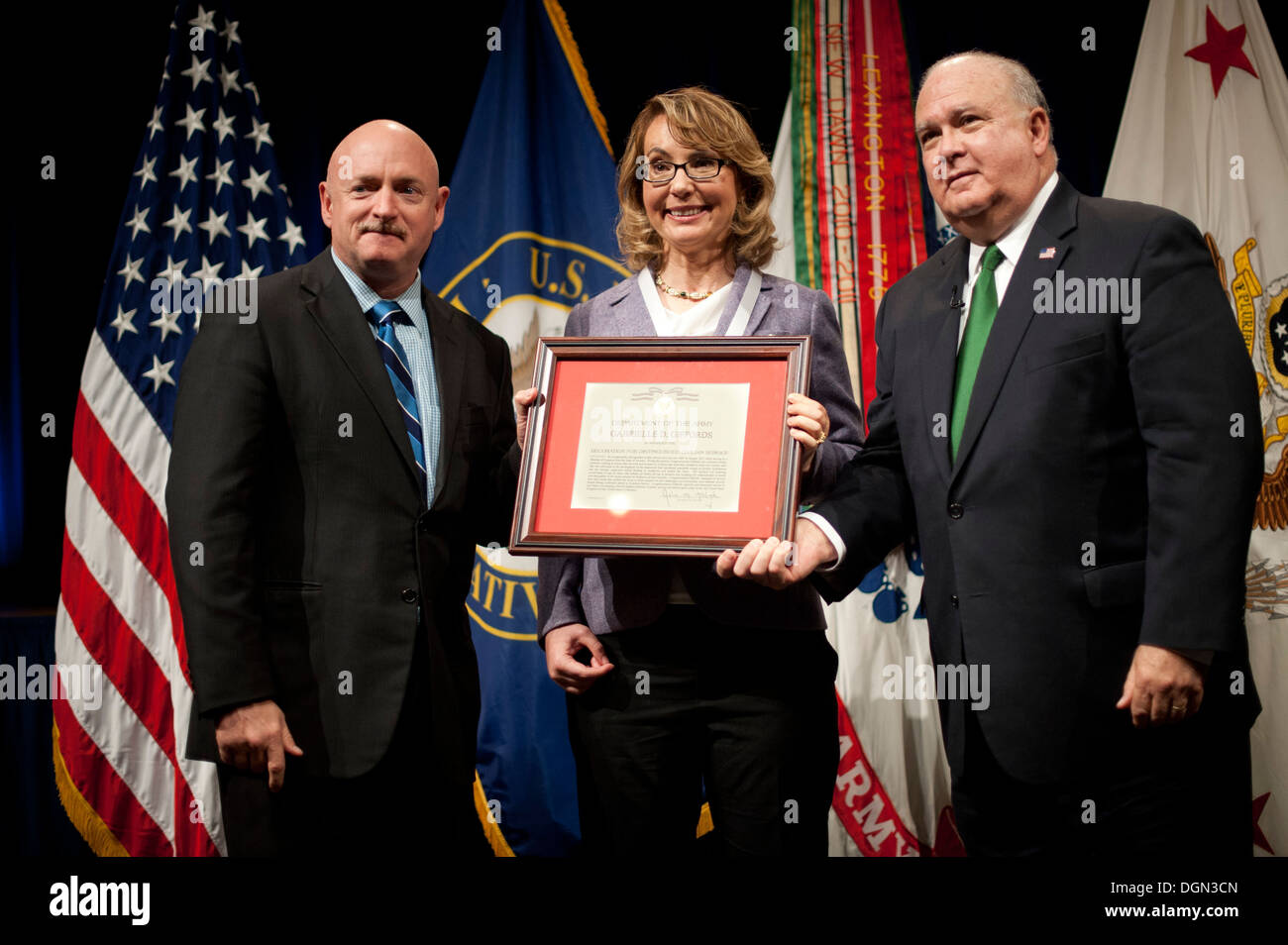 Under Secretary of the Army Joseph W. Westphal (far right) presents the Army Decoration for Distinguished Civilian Service to former Rep. Gabrielle 'Gabby' Giffords (Ariz.) for 'outstanding public service and support of the Army's missions', October 10, 2 - Stock Image