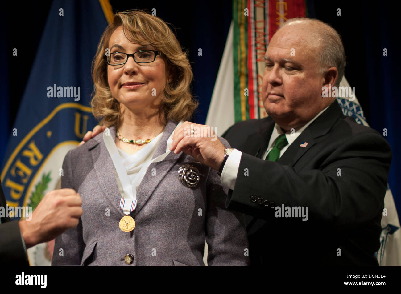 Under Secretary of the Army Joseph W. Westphal presents the Army Decoration for Distinguished Civilian Service to former Rep. Gabrielle 'Gabby' Giffords (Ariz.) for 'outstanding public service and support of the Army's missions', October 10, 2013 at the P - Stock Image