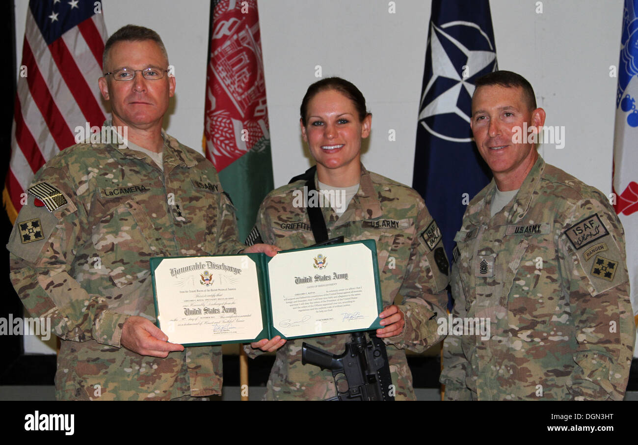 Spc. Brittany A. Griffith, a native of Lewistown, Pa., assigned to the 15th Sustainment Brigade, kicked off the new fiscal year - Stock Image