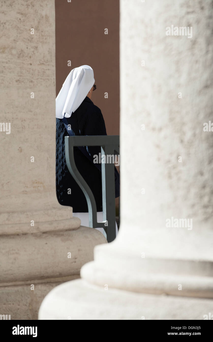Nun walk in St Peter's colonnades Stock Photo
