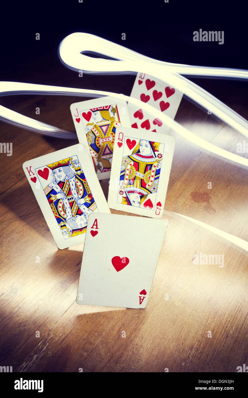 Poker Heart Royal Flush with light trails - Stock Image