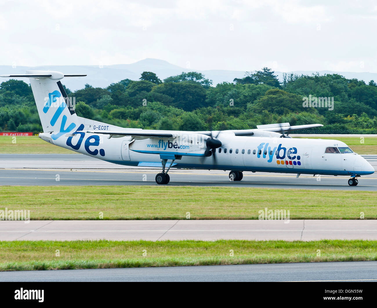 FlyBe Bombardier DHC-8 Q400 Dash8 Airliner Taxiing at Manchester Airport England United Kingdom - Stock Image