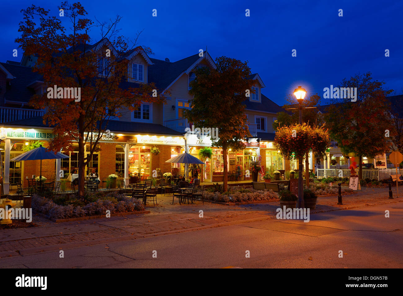 Patio eateries on Islington Avenue at dusk in Kleinburg Ontario - Stock Image