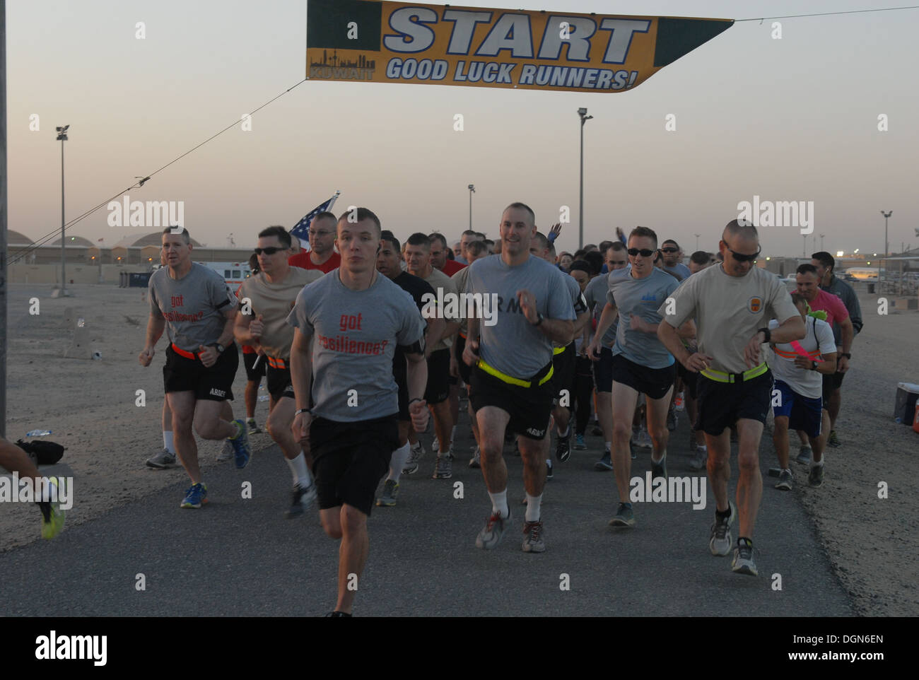 Soldiers begin running at the start line of the shadow run of the Dublin 5K to honor Capt. Nicholas Rozanski on Oct. 12, 2013 at Camp Arifjan, Kuwait. The shadow race, organized by the 371st Sustainment Brigade, an Ohio Army National Guard unit, honors th - Stock Image