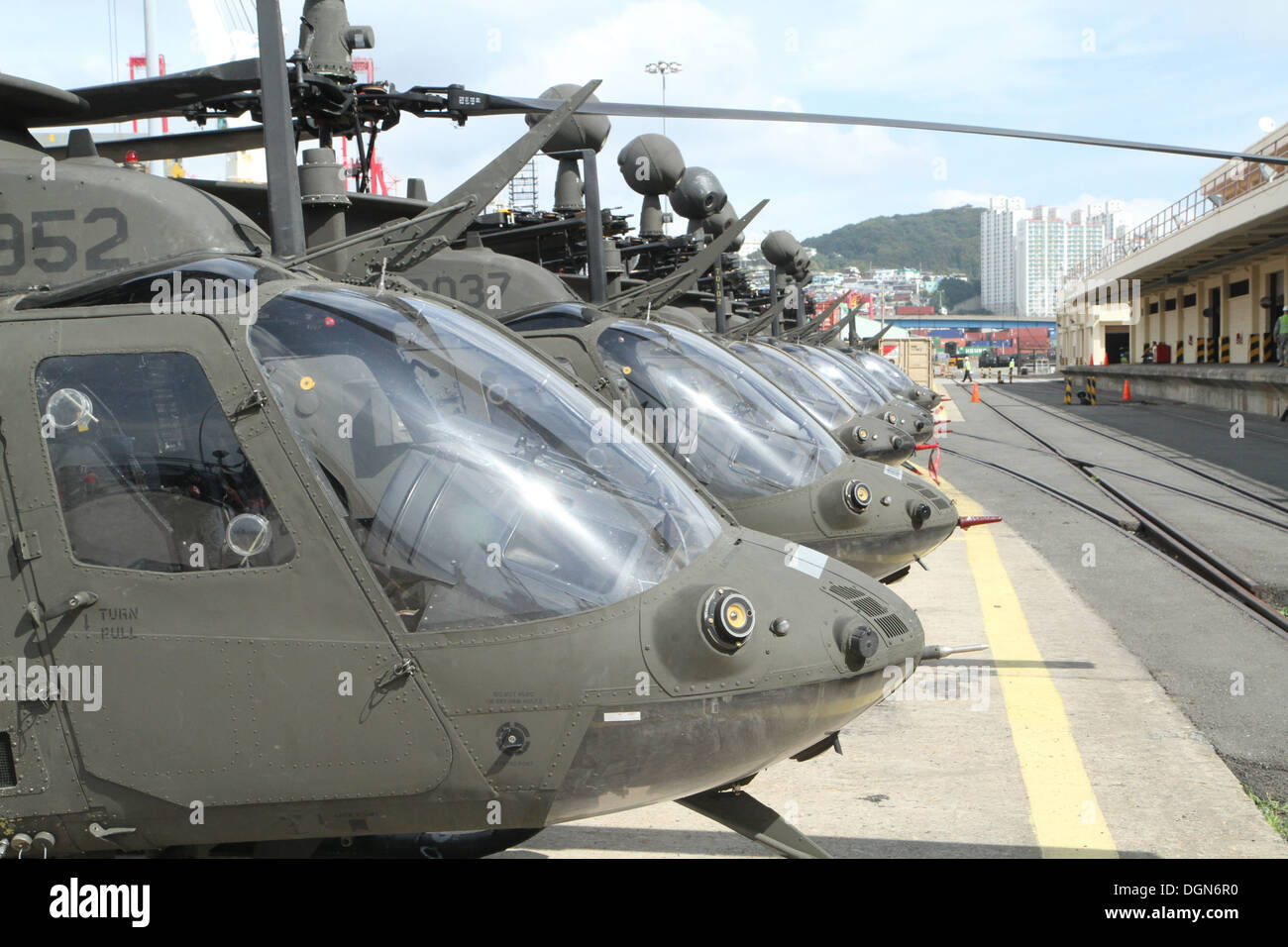 The OH-58D Kiowa Warrior helicopters are staged at Pier 8, Busan, Oct. 10. The 380 soldiers from the 4th Squadron, 6th Cavalry Regiment, and 30 OH-58D KW helicopters will deploy to the 2nd Combat Aviation Brigade. - Stock Image