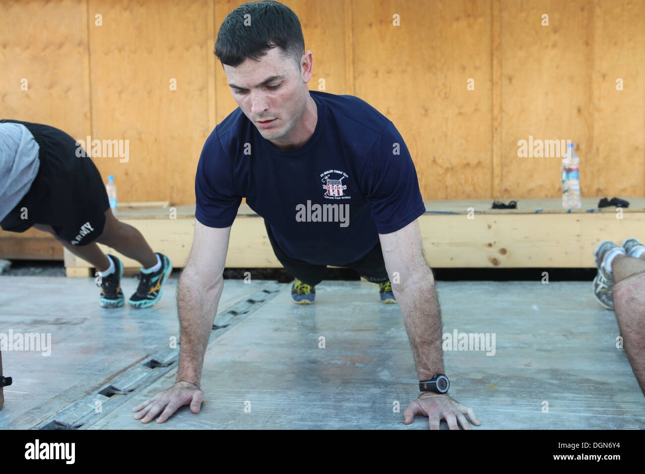 U.S. Army Capt. Kyle Greer, brigade planner, 4th Brigade Combat Team, 10th Mountain Division, does metronome push-ups as part of the Mountain Athlete Warrior physical assessment at Forward Operating Base Gamberi, Laghman province, Afghanistan, Oct. 15, 20 - Stock Image