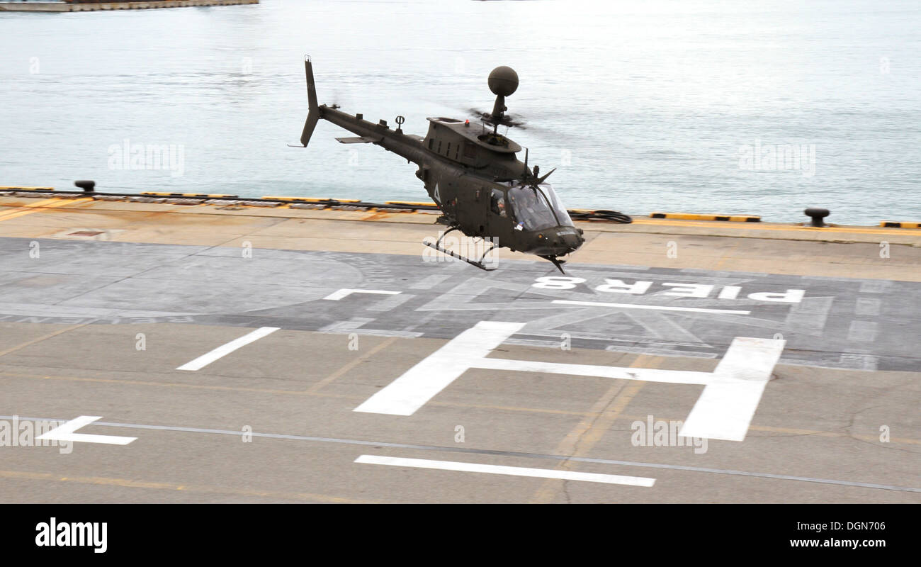 One of the OH-58D Kiowa Warrior helicopters departs for Camp Humphreys, South Korea, to rejoin the 2nd Combat Aviation Brigade Oct. 10 at Pier 8, Busan. The 380 soldiers from the 4th Squadron, 6th Cavalry Regiment, and 30 OH-58D KW helicopters will deploy - Stock Image