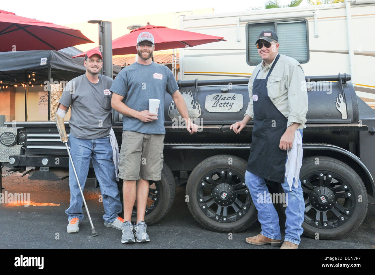 From left, Michael Lackey, Madux Hobbs and Robert Flowers, members of the Black Betty Barbecue team from Roswell, N.M., present - Stock Image