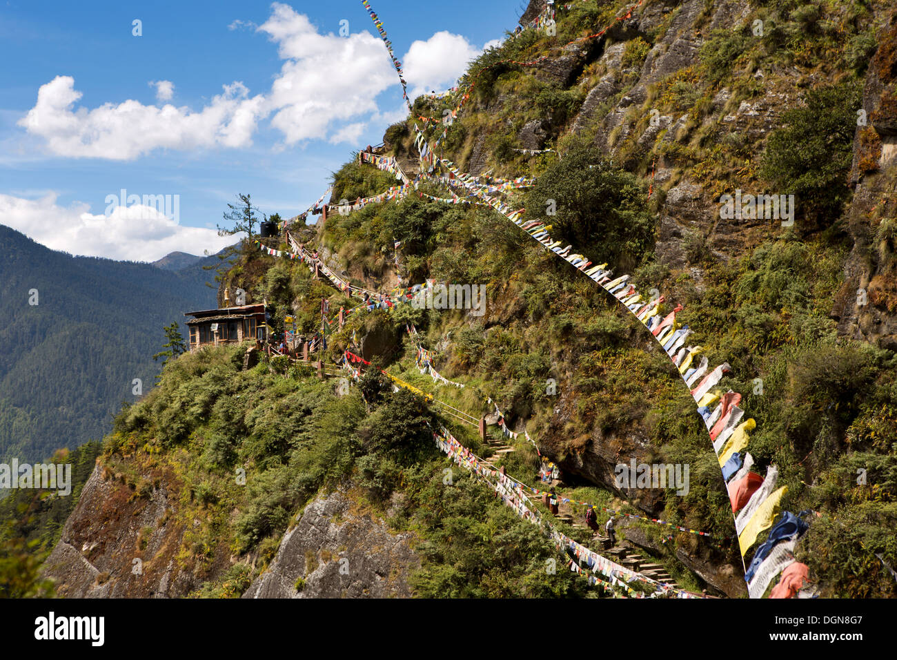 Bhutan, Paro valley, prayer flags above path to Taktsang Lhakang (Tiger's Nest) monastery - Stock Image