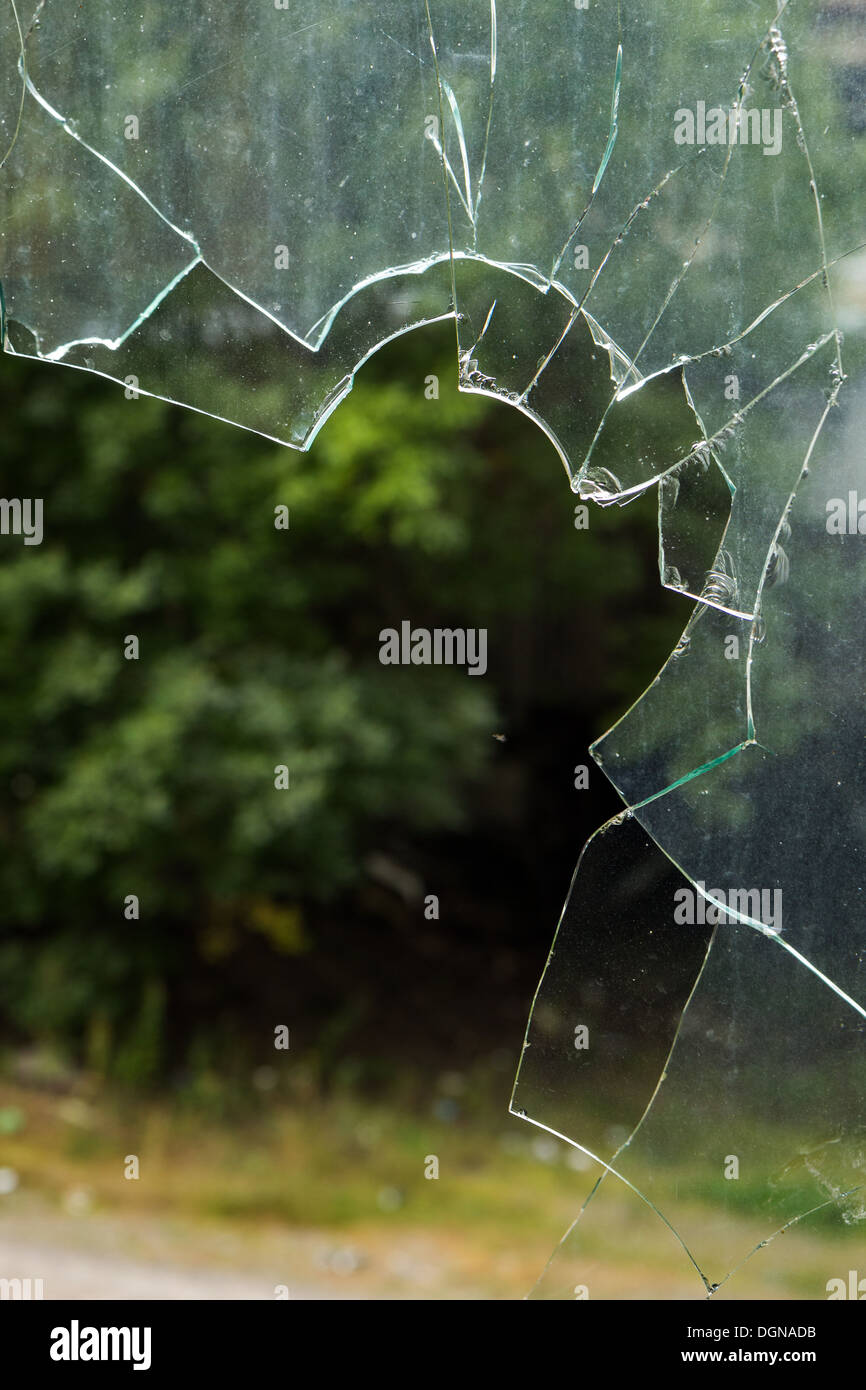 Closeup of broken window glass - Stock Image