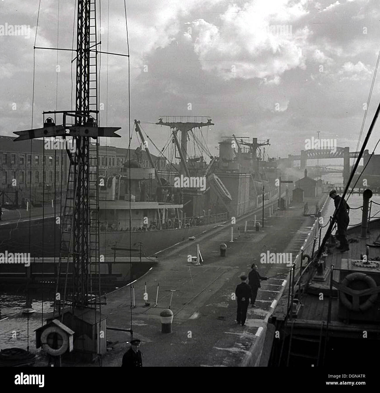 1950s, historical picture of a large ship moored quayside at the docks, Newcastle-upon-Tyne, England, UK. - Stock Image