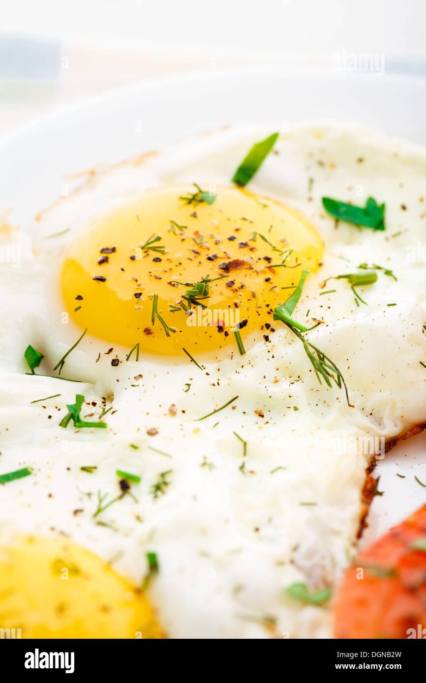 Fried egg close-up - Stock Image