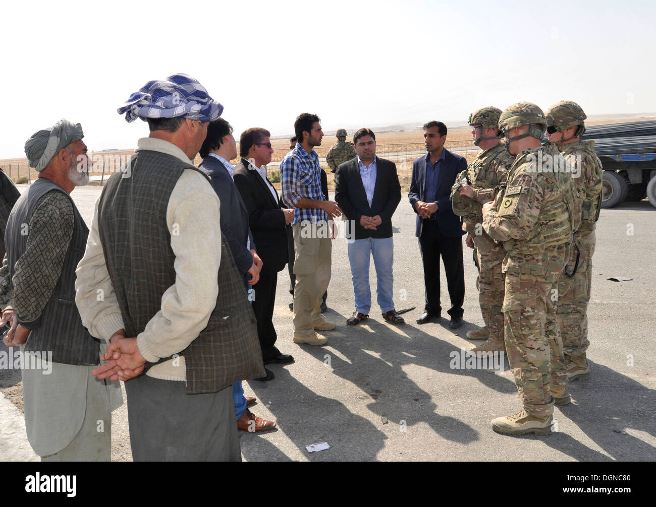 Members of the key leader delegation of Afghanistan Ministry of Customs and Industry, along with 1st Theater Sustainment Command, Afghan Rail Advisory Team discuss ways to improve rail Port 4. - Stock Image