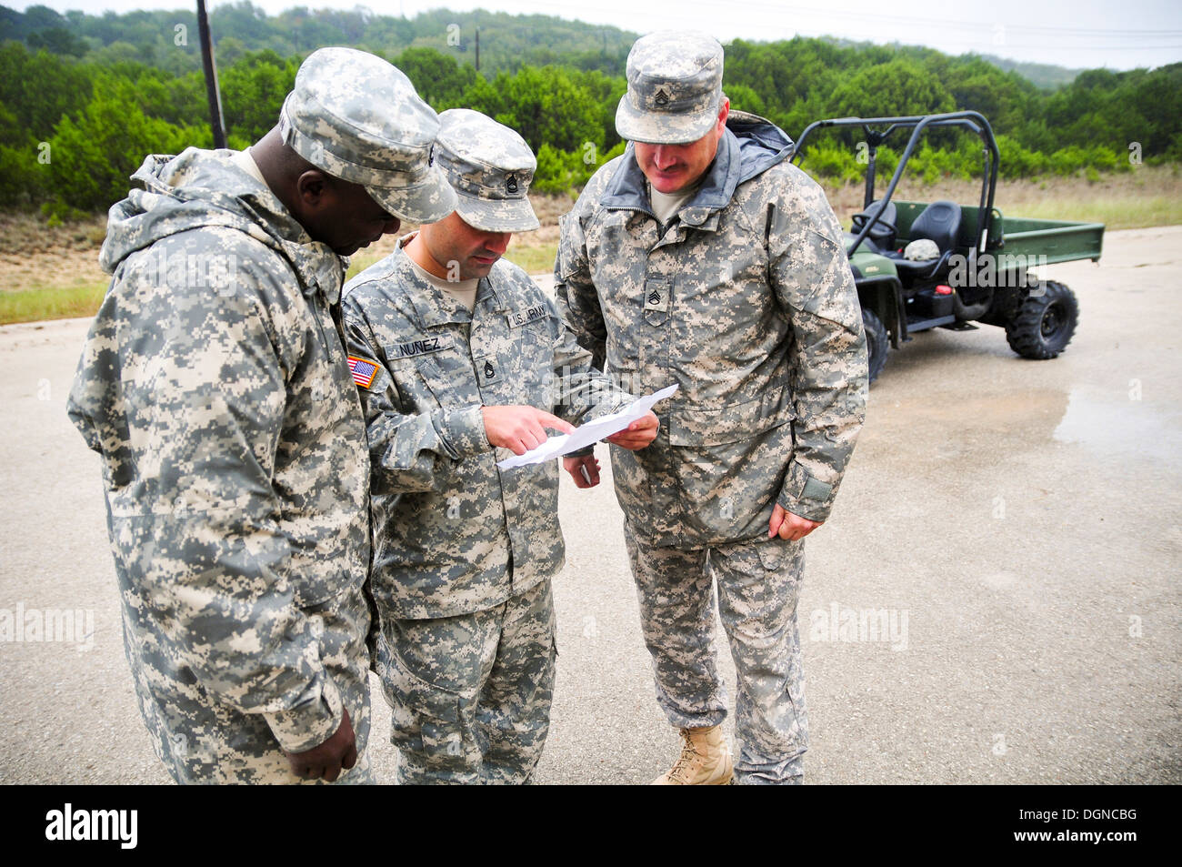 (from left to right) Sgt. 1st Class Scoefield McMillan, with 13th Sustainment Command (Expeditionary) Support Operations' Integr - Stock Image