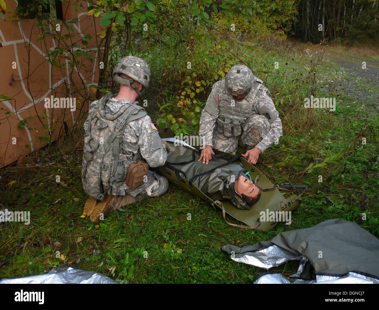 Soldiers from the 10th Army Air and Missile Defense Command prepare a mock casualty for transport during a training exercise at - Stock Image