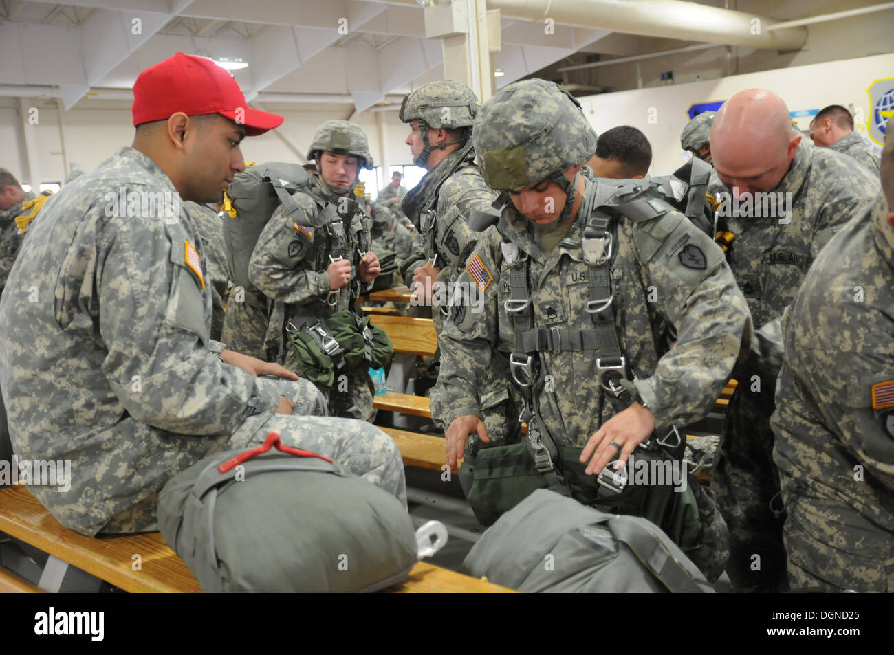 Spartan paratroopers with the 4th Infantry Brigade Combat Team (Airborne), 25th Infantry Division, go through a thorough inspection before a jump Oct. 17, 2013, on Joint Base Elmendorf-Richardson, Alaska. Jumpmasters and riggers are responsible to insure - Stock Image