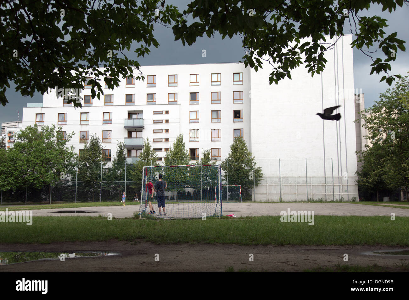 Warsaw, Poland, boys play football in their spare time on a school playground - Stock Image