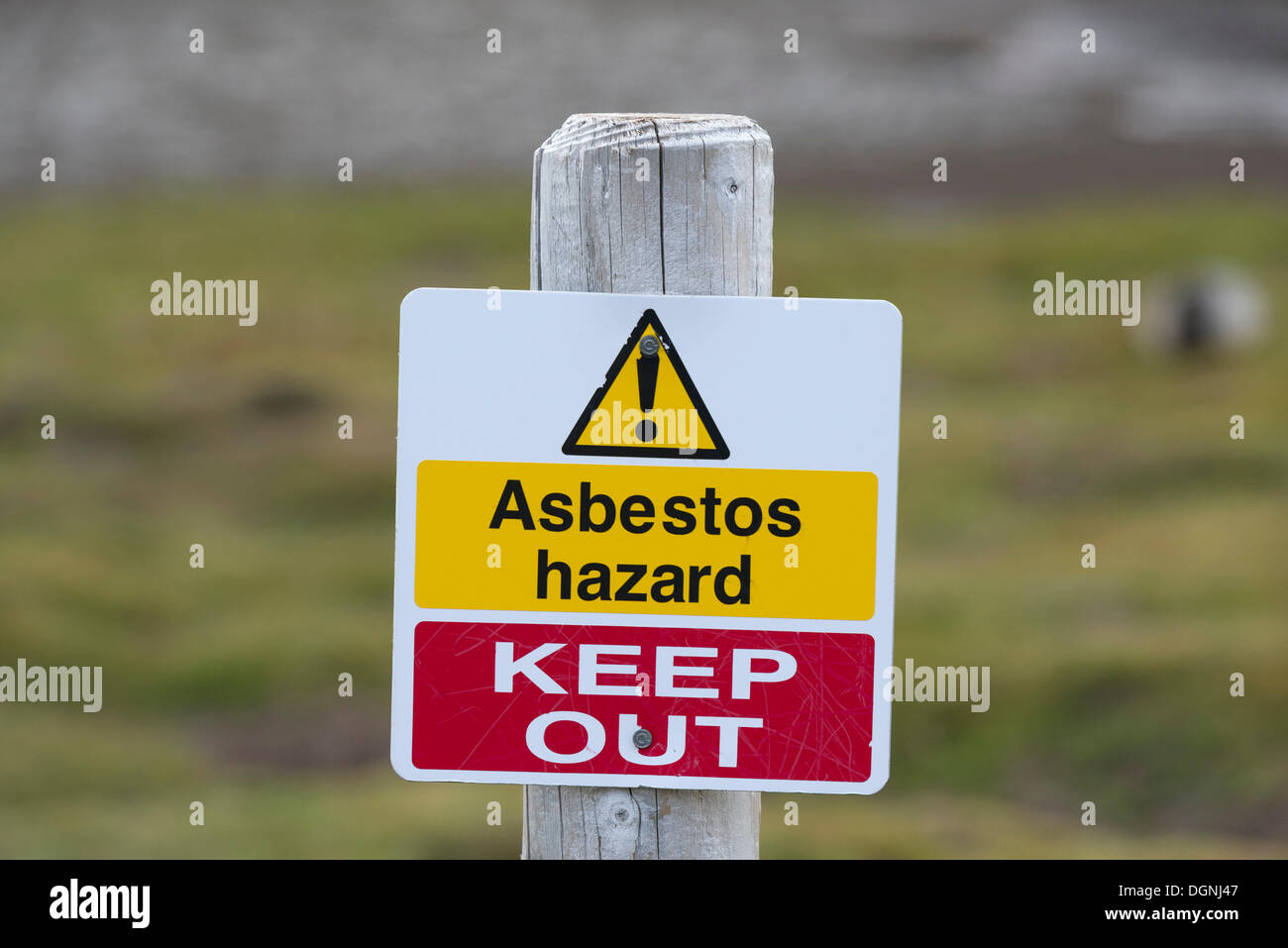 Warning sign 'Asbestos hazard - keep out' at the Stromness whaling station, Stromness Bay, South Georgia and the South Sandwich - Stock Image