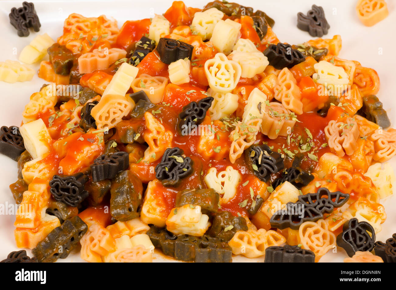 Spooky pasta, a plate of Halloween party kid food - Stock Image