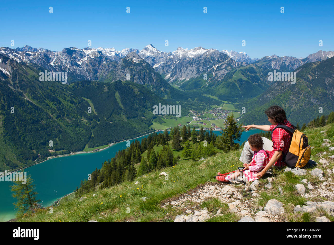 Hikers and Lake Achensee as seen from Durrakreuz viewpoint, Tyrol, Austria, Europe - Stock Image